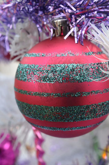 red ornament with glitter stripes hanging on white Christmas tree Celebration Christmas Christmas Decorations Christmas Time Christmas Tree Close-up Glitter Holiday No People Ornament Red Vintage Christmas Decorations White Color