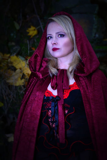 Beautiful Woman In Little Red Riding Hood Costume At Forest