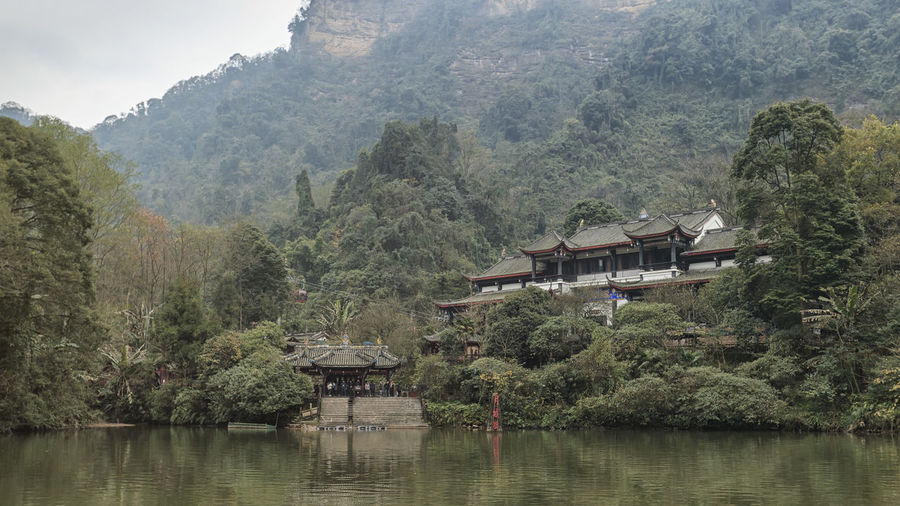 Dujiangyan, China - December 12, 2018: Buddhist temple in the Qingcheng mountain area close to Chengdu Chengdu China ASIA Dujiangyan Temple Boat Lake Cloud - Sky Tree Mountain Plant Architecture Water Built Structure
