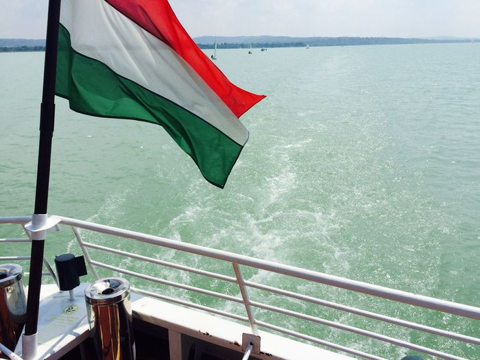 Hungarian flag on boat in sea