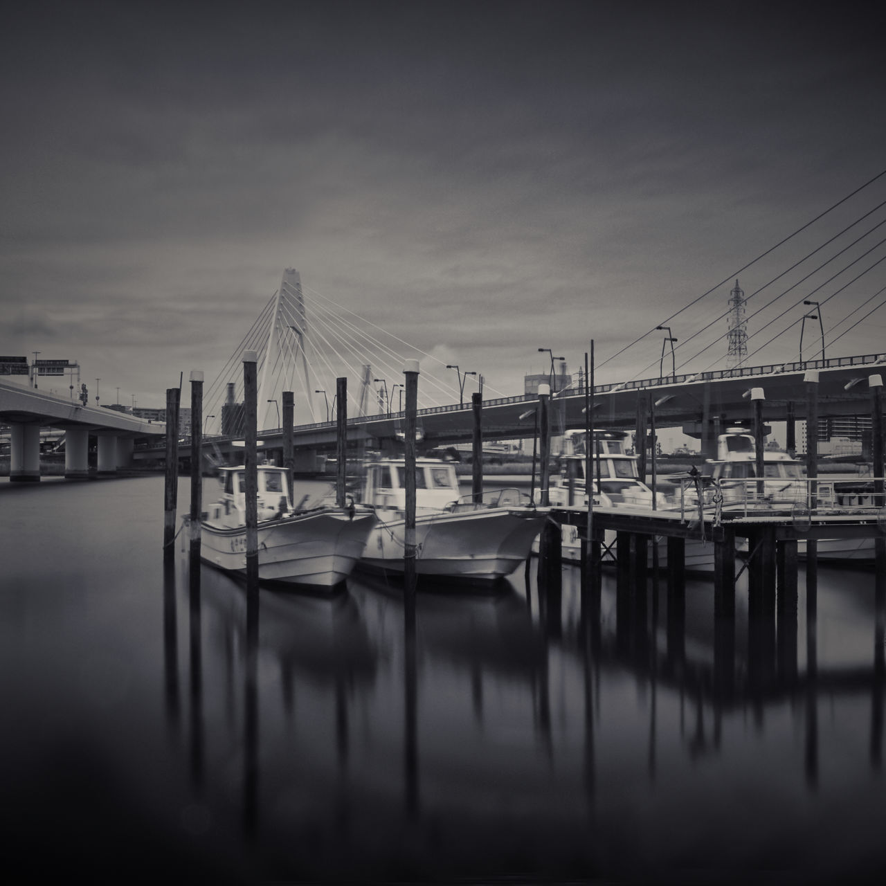 water, reflection, transportation, no people, built structure, architecture, waterfront, sky, mode of transport, nautical vessel, river, harbor, outdoors, commercial dock, building exterior, moored, day, nature, industry, shipyard