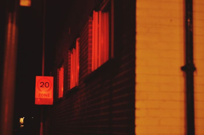 Red Light. Urbanphotography Exeter World EyeEm Selects Text Communication Red Built Structure Architecture Building Exterior No People Night Neon Outdoors HUAWEI Photo Award: After Dark