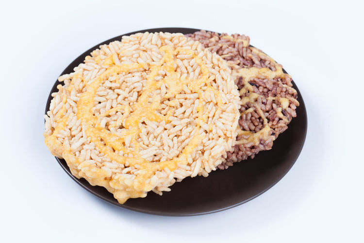 Nangled Background Breakfast Brown Cake Cane Circle Copy Cracker Crispy Culture Deep Delicious Dessert Drizzle Eat Flavour Food Fried Gourmet Grain Healthy Isolated Meal Natural Nutrition Organic Plate Puffed Rice Snack Space Sticky Sugar Sweet Tasty Thai Thailand Top Traditional White