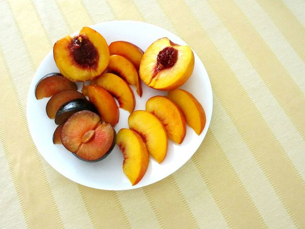 a plum, peach and nectarine Food Freshness Ready-to-eat High Angle View No People Plate Fruit Sliced Fruit Sliced Fruits Fruits Plum Peach Nectarine