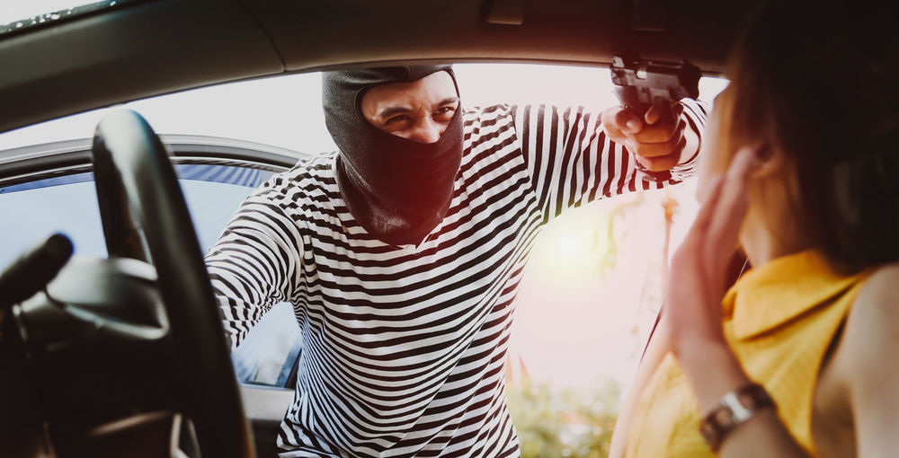 Asian women are being mugged, robbed of cars and property. Self-Defense Concept