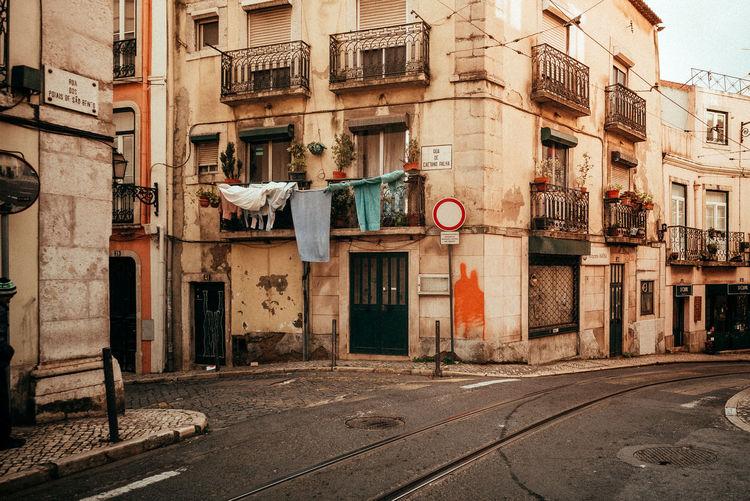 Road by buildings in city
