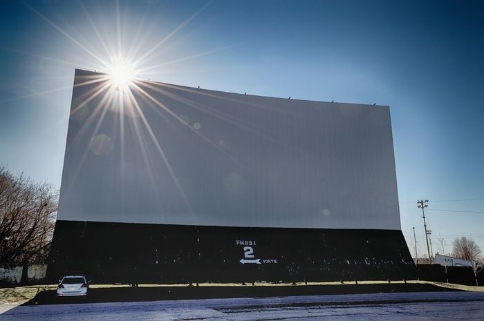 Architecture Cinema Clear Sky Day Drive-in Theater Movie Theater Movie Time No People Outdoors Perspective Photography Retro Screen Sky Stadium Sun