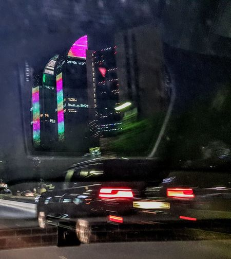 Reflection on my car's glass Illuminated City Land Vehicle Car Road Architecture Built Structure Building Exterior Light Trail Car Point Of View High Street Car Interior Rear-view Mirror Light Painting Tail Light Road Marking Moving Vehicle Light Highway Empty Road Tall - High Speedometer Traffic