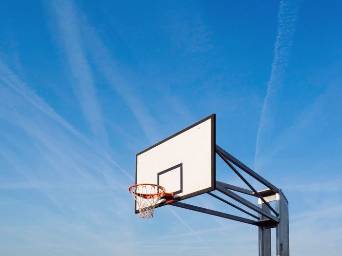 Basketball hoop Geometric Shape Low Angle View Basketball - Sport Blue Basketball Hoop Sky Sport No People Nature Court Copy Space Outdoors Clear Sky Net - Sports Equipment Basketball - Ball Baseball - Sport Absence Day