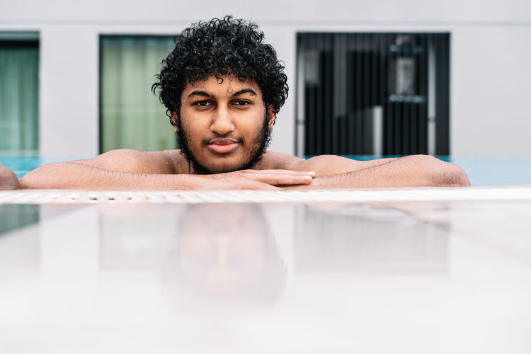 Portrait of mid adult man in swimming pool