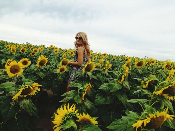 EyeEm Selects Only Women One Woman Only Nature Adults Only Adult Flower One Person Field Portrait Long Hair Summer Rural Scene Beautiful Woman Cloud - Sky Beauty Fashion Women Day Sky