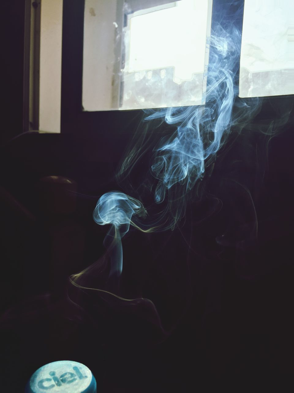 smoke - physical structure, indoors, real people, window, one person, close-up, day, people