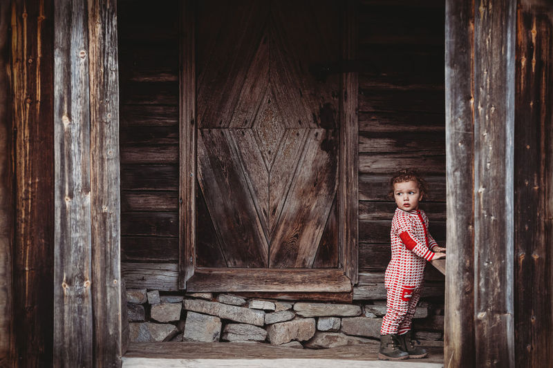 Portrait of girl standing on wood