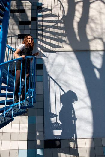 Shadow of woman on railing