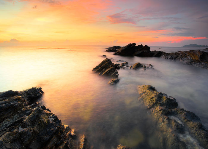 Sunrise over the sea Lost In The Landscape Beauty In Nature Day Horizon Over Water Nature No People Outdoors Rock - Object Scenics Sea Sky Sunset Tranquil Scene Tranquility Water