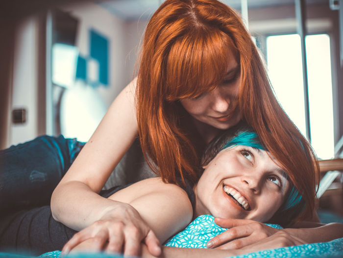 Adult Bonding Couple - Relationship Emotion Furniture Hairstyle Happiness Headshot Home Interior Indoors  Leisure Activity Lesbian Lgbt Lifestyles Portrait Positive Emotion Real People Relaxation Togetherness Two People Women Young Adult Young Women