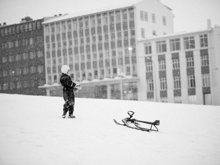 Architecture Building Exterior Built Structure Child City City Life Day Full Length Office Building Outdoors Riding Sledding Walking Winter