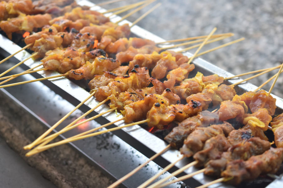 chicken satay Barbecue Charcoal Chicken Satay Close-up Day Delicous Food Focus On Foreground Food Food And Drink Freshness Grilled Healthy Eating Kebab Malaysia Truly Asia Malaysian Food Meat No People Outdoors Ready-to-eat Satay Serving Tongs Skewer Squid
