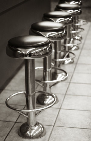 STOOLS Bar Stool Blackandwhite Photography Focus On Foreground In A Row Indoors  Metal Seat Stools
