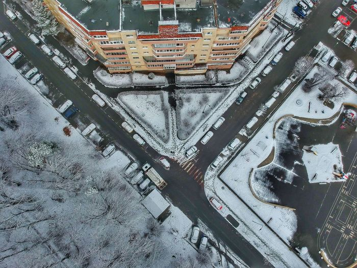 Aerial view of snowy road in city
