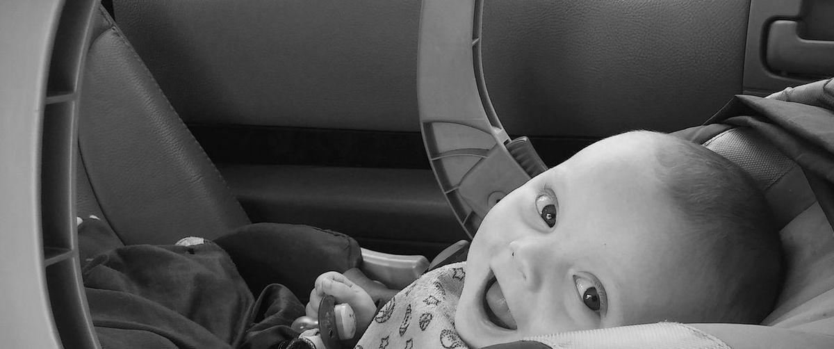 Portrait of cute baby boy in car