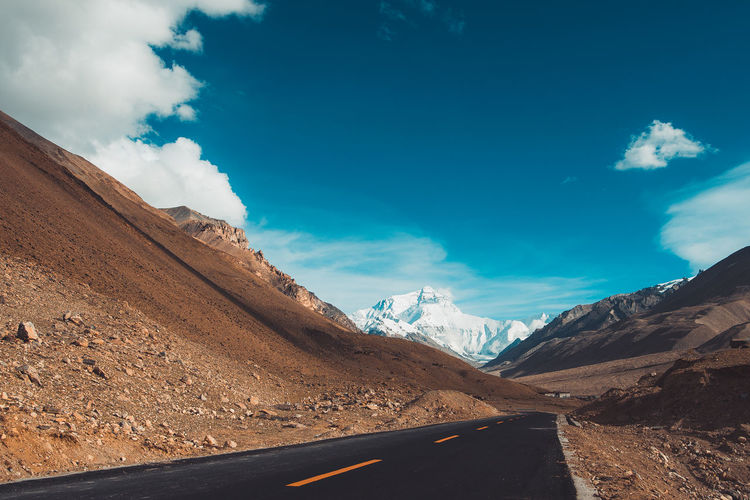 On the way to Mount Everest Mountain Cloud - Sky Road Beauty In Nature Scenics - Nature Transportation Tranquil Scene Landscape Tranquility Non-urban Scene Nature Mountain Range Environment Idyllic Blue Travel Sunlight Formation Snowcapped Mountain Himalayas Tibet Everest High Altitude EyeEm Selects