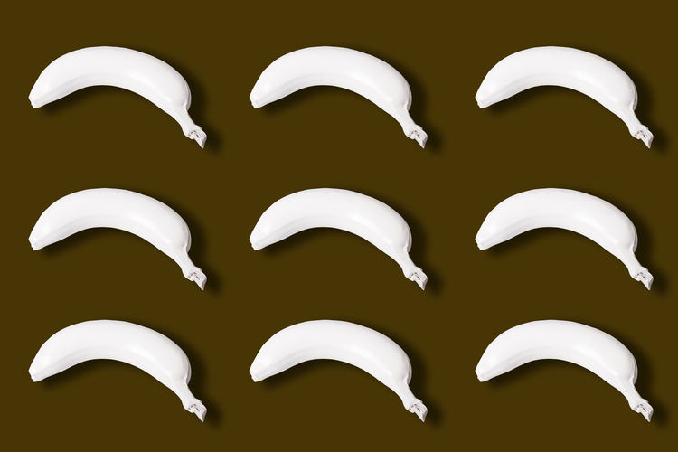 many white colored bananas isolated on brown background Bananas Many White Isolated Brown Color Background View Top Colored Abstract Fresh Healthy Natural Food Fruit Ripe Delicious Snack Dessert Nutrition Freshness Diet Concept Vitamin Gourmet Organic Plant Tropical Creative Whole Nature Art Nutritious Layout Design Breeding Macro Style Peel Skin Sweet Pattern Bright Lay Vegetarian Tasty Above Raw Idea