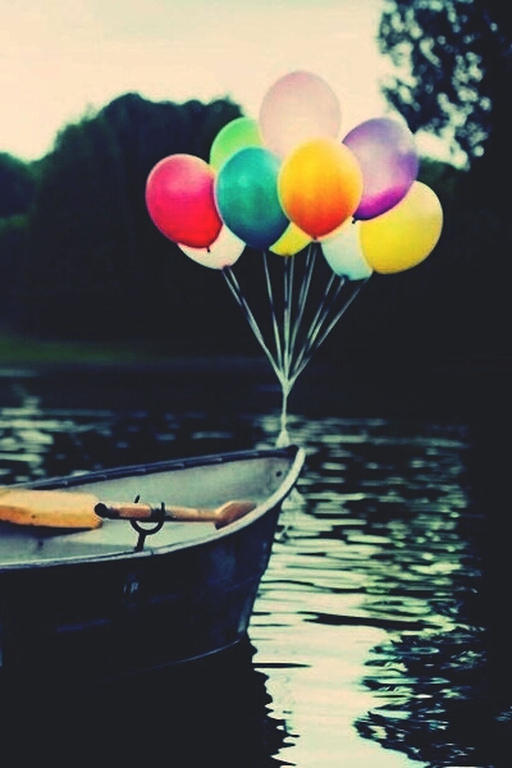 water, multi colored, reflection, colorful, waterfront, lake, focus on foreground, nature, close-up, beauty in nature, boat, no people, floating on water, nautical vessel, day, tranquility, outdoors, balloon, toy, childhood