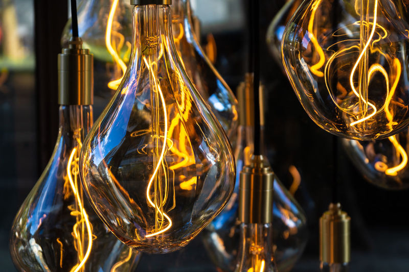 Household Equipment Close-up Electric Light Electricity  Filament Focus On Foreground Glass Glass - Material Glowing Illuminated Indoors  Light Light Bulb Lighting Equipment Motion No People Reflection Technology Transparent Yellow Capture Tomorrow Humanity Meets Technology