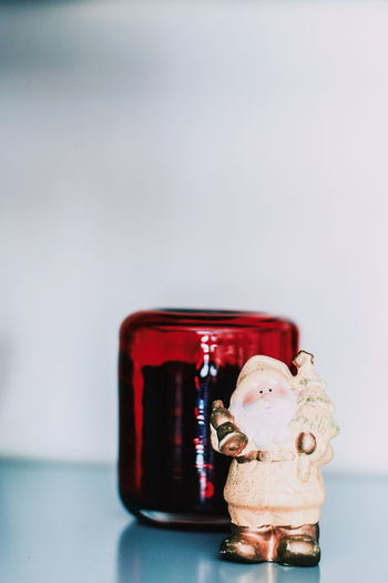 Close-Up Of Santa Claus Figurine On Table