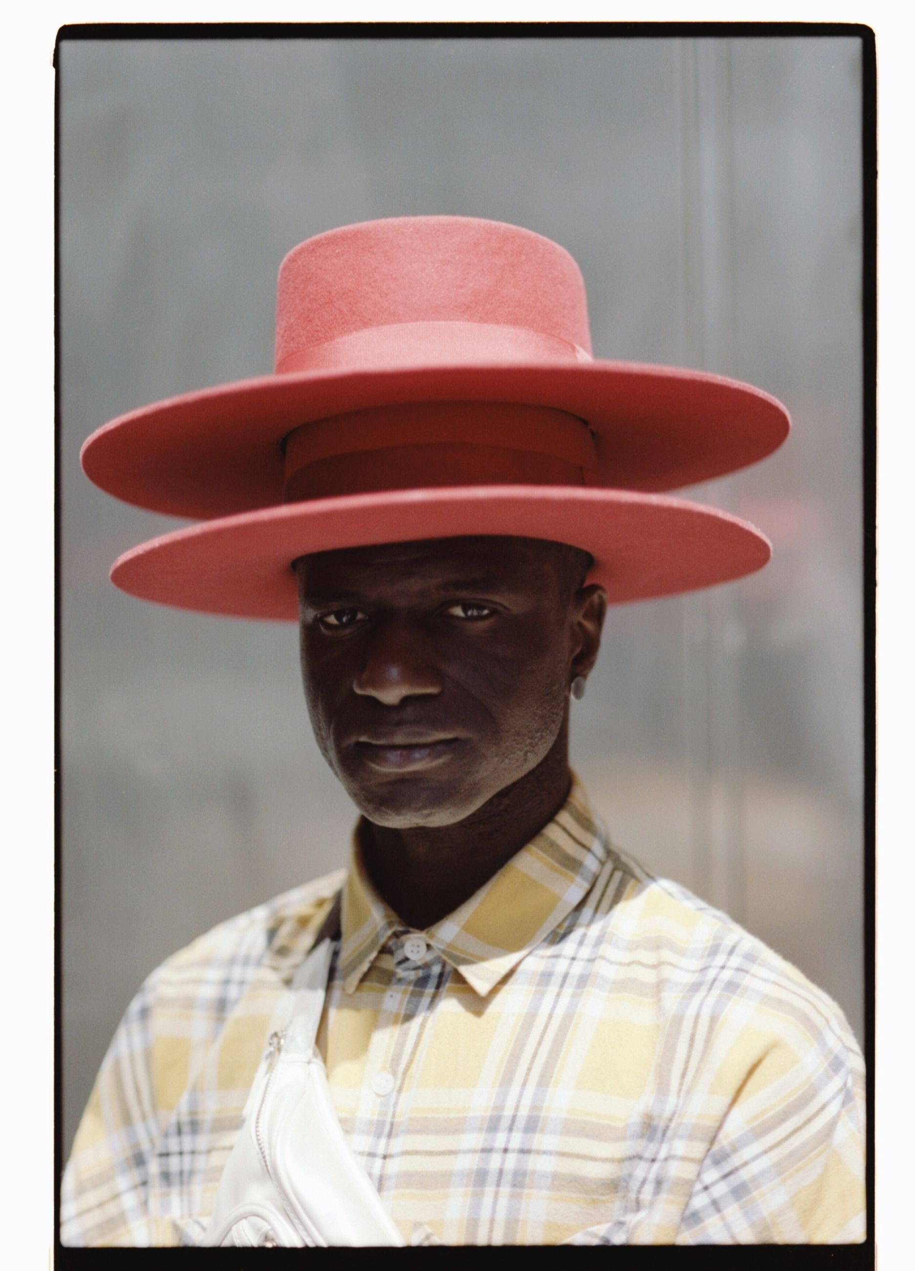 portrait, one person, hat, looking at camera, men, headshot, real people, clothing, young men, front view, lifestyles, males, adult, standing, transfer print, focus on foreground, leisure activity, indoors, young adult, mature men