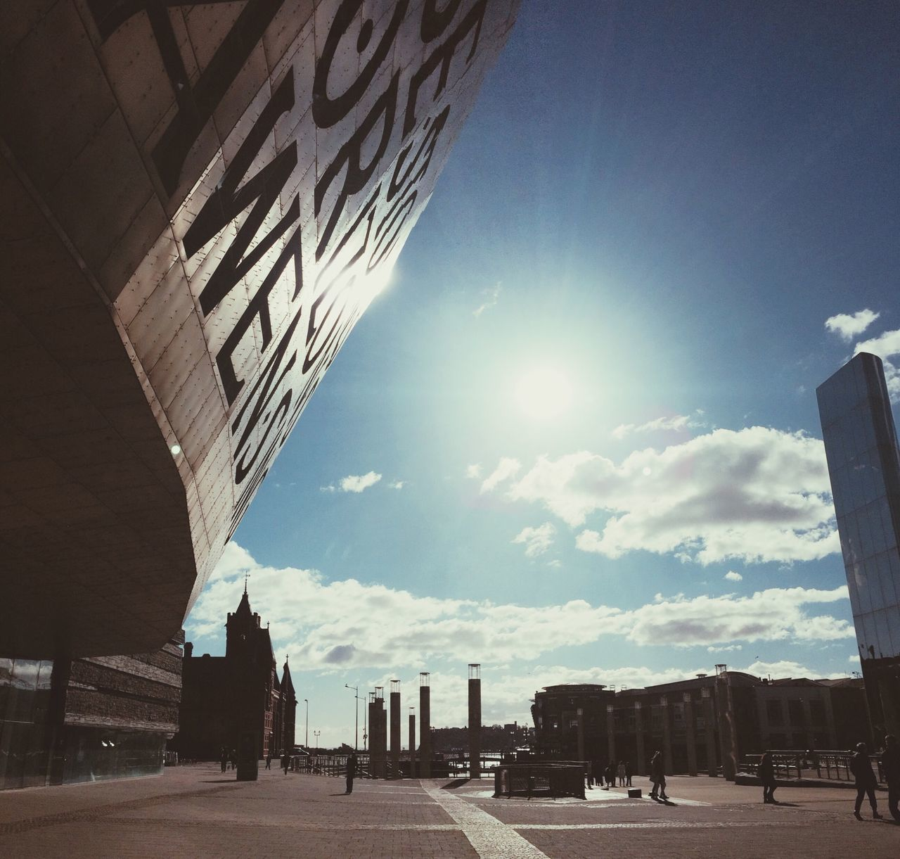 built structure, architecture, sky, sunlight, building exterior, outdoors, day, city, no people, nature