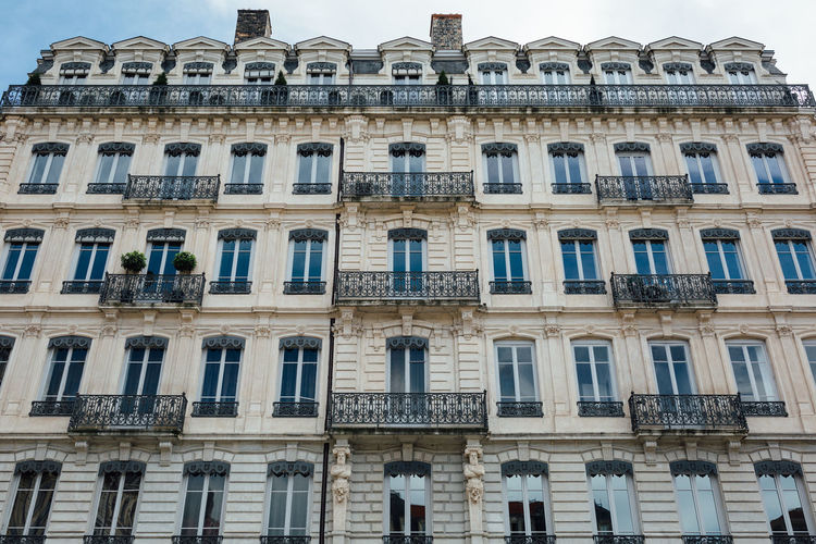 Beautiful stylish european apartment building facade. Façade Apartment Architecture Building Building Exterior Built Structure City Day Façade French History Low Angle View Outdoors Residential District Sky Style The Past Travel Destinations Window