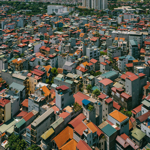 High angle view of residential buildings in city