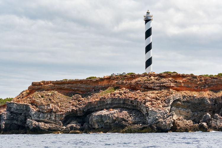 Lighthouse on the northern rocky coast of Ibiza Island. Balearic island, Spain Coastline Ibiza Ibiza, Spain Landscape_Collection Lighthouse Mediterranean Sea Rock Formation Rocky Coastline SPAIN Balearic Islands Beauty In Nature Cloud - Sky Island Landscape Mountain Nature No People Nobody Outdoors Rocky Mountains Scenery Sea Sky Water Waterfront