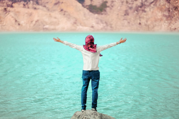 Turquoise Colored Outdoors Vacations Arms Raised Full Length Front View Freedom Leisure Activity Lifestyles Nature Volcanic Crater Kawah Putih Bandung Travel Woman In Hijab Volcanic Lake International Women's Day 2019