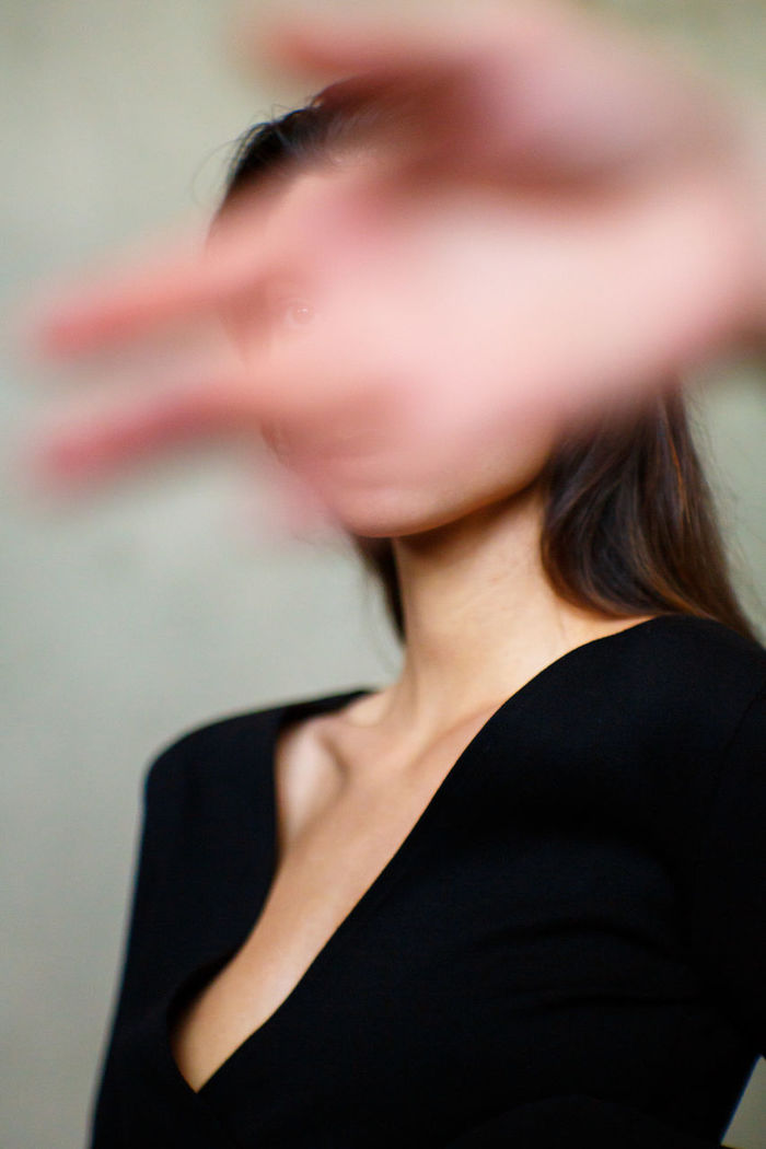 Hand against woman
