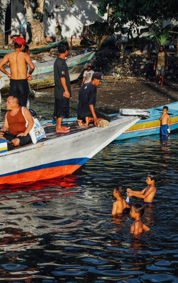 ASIA Asian  Banda Banda Island Boat Boys Childhood Day INDONESIA Large Group Of People Leisure Activity Medium Group Of People Men Outdoors Person Water Waterfront