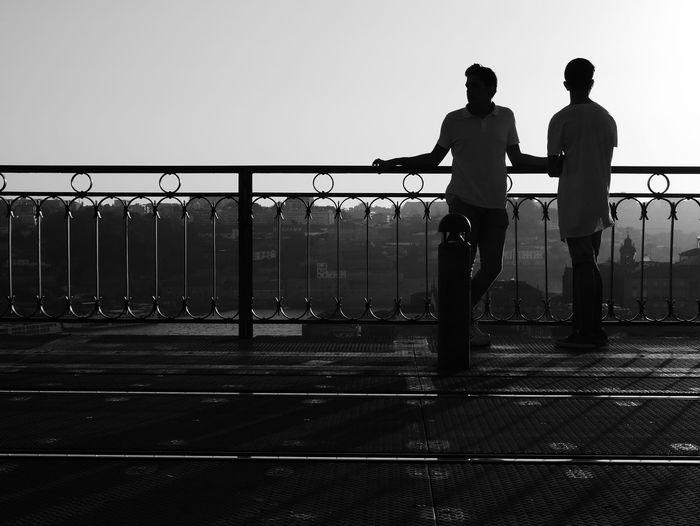 Men standing on bridge