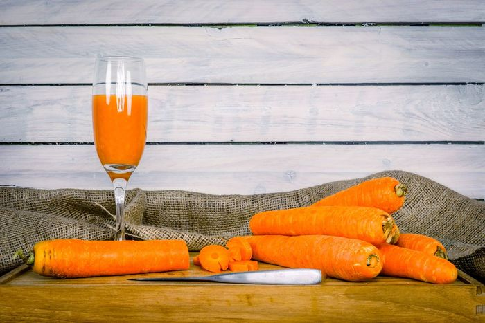 Carrots on a table with a glass of juice Vegetables Betacarotene Healthy Carrot Juice Carrots Food And Drink Orange Color Drink Freshness No People Drinking Glass Healthy Eating Wood - Material Refreshment Indoors  Close-up Table Food Day