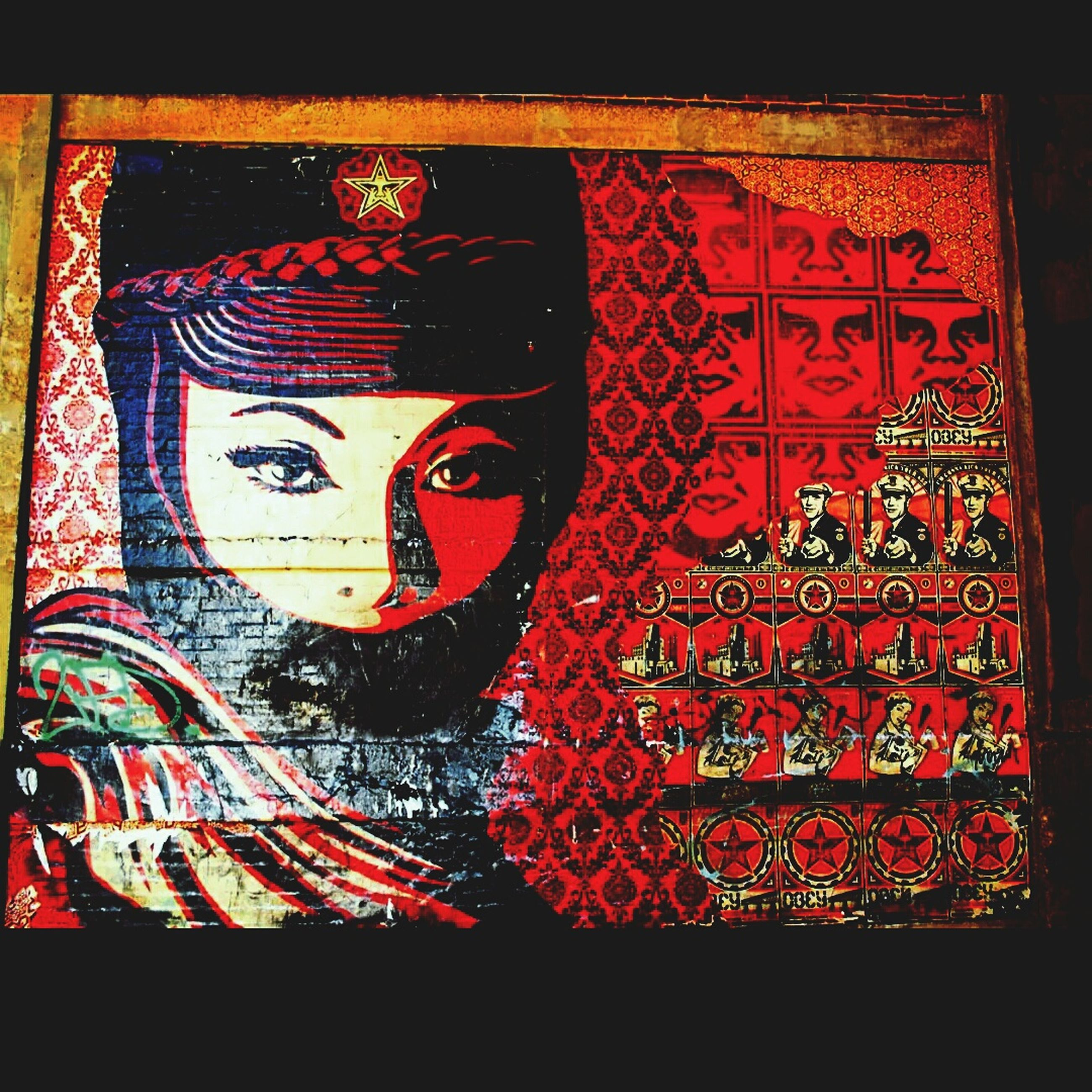 indoors, red, art and craft, art, creativity, human representation, close-up, wall - building feature, black background, front view, pattern, no people, fabric, design, auto post production filter, religion, dark, cultures