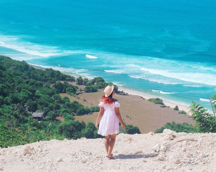 Freedom Sea One Person Water Beach Land Clothing #FREIHEITBERLIN Real People Leisure Activity Women Nature Sunlight Rear View Hat Full Length Day Lifestyles Standing Dress Fashion Outdoors The Great Outdoors - 2018 EyeEm Awards