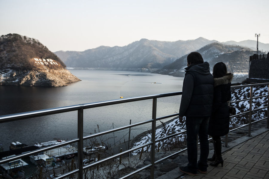 Clear Sky Escapism Getting Away From It All Mountain Mountain Range Outdoors Railing Rear View Sea Snow Soyang Lake Staircase Steps Steps And Staircases The Way Forward Togetherness Tranquil Scene Unhampered Vacations Walking Water Weekend Activities Winter