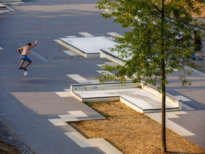 URBANANA #urbanana: The Urban Playground Skateboarding Architecture Available Light Building Exterior Built Structure City Day Footpath Full Length Jumping Mid-air Nature One Person Outdoors Plant Shadow Street Streetphotography Sunlight Swimming Pool Tree Trick  urban sports Water