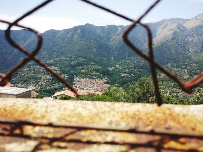 Roquebiliere ⛰️ Chainlink Fence Protection Safety Metal Day Outdoors Focus On Background Mountain Nature Building Exterior Barbed Wire No People Sky Close-up Tranquility Beauty Nature Côte D'Azur Freshness Travel Destinations Growth Tree Forest Beauty In Nature France