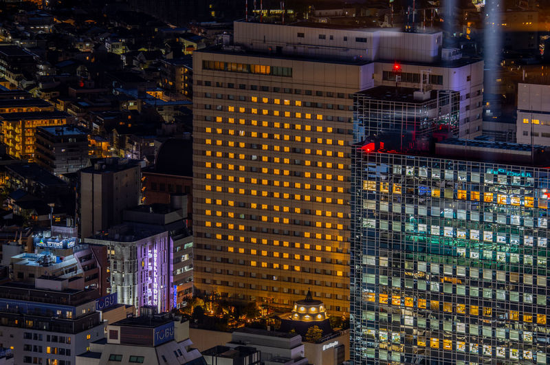 High angle view of smile illuminated buildings at night