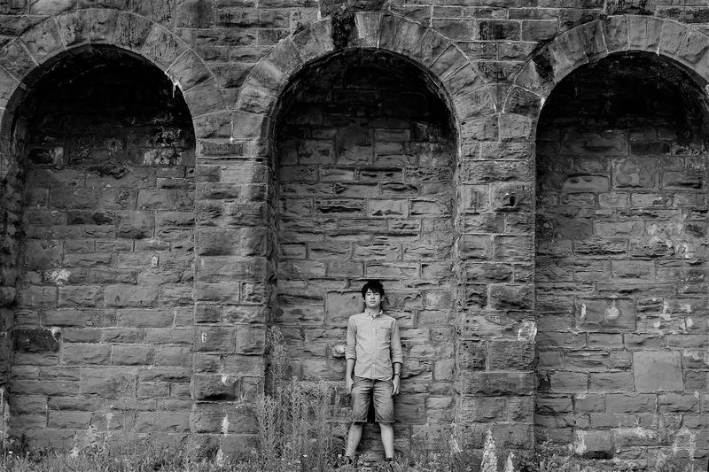 Under the Arches Brick Wall Cool Jeans Looking At Camera Youth Youth Of Today Adult Arch Architecture Blackandwhite Brick Wall Built Structure Casual Clothing Full Length One Person Outdoors People Portrait Real People Standing Teen Teenager Young Adult Young Men Youth Culture The Week On EyeEm Lost In The Landscape Be. Ready. Fashion Stories The Graphic City This Is Masculinity Stories From The City Inner Power Visual Creativity Urban Fashion Jungle Summer In The City Autumn Mood Redefining Menswear Skate Photography: Same Tricks, New Perspectives The Art Of Street Photography British Culture