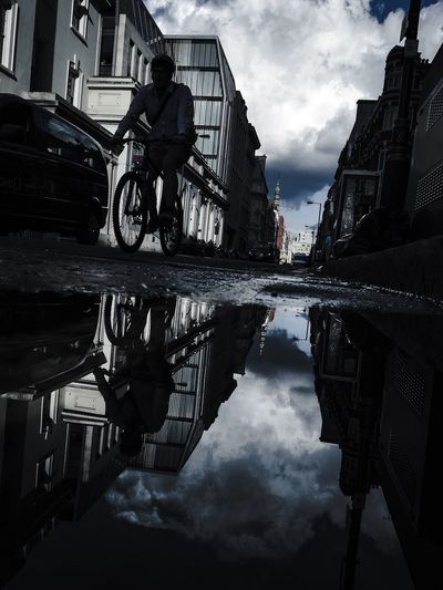 Reflections Of London Urban Exploration Diminishing Perspective Bike Rider Abstract Photography Urban Creativity Shadow And Light Reflection EyeEm Best Shots Fresh On Eyeem  Fine Art The Week Of Eyeem Eyeemphotography EyeEm Best Shots - Architecture Fine Art Photography EyeEm Best Shots - The Streets Leading Lines Central London Streetphotography Cloud Silhouette City Life Puddle Architecture