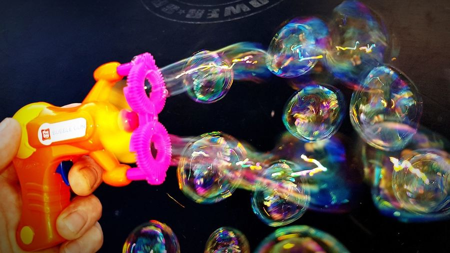 Human Body Part People Close-up One Person Bubblegun Bubbles Multi Colored Holding Human Finger Human Hand Paint The Town Yellow