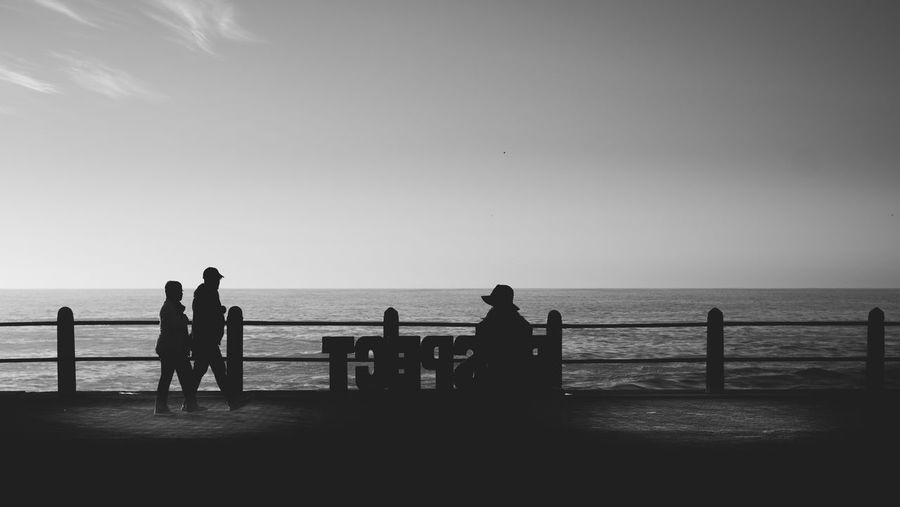 Beach Beauty In Nature Clear Sky Day Horizon Over Water Lifestyles Men Nature Outdoors People Real People Scenics Sea Silhouette Sky Standing Sunset Three People Vacations Water The Street Photographer - 2017 EyeEm Awards